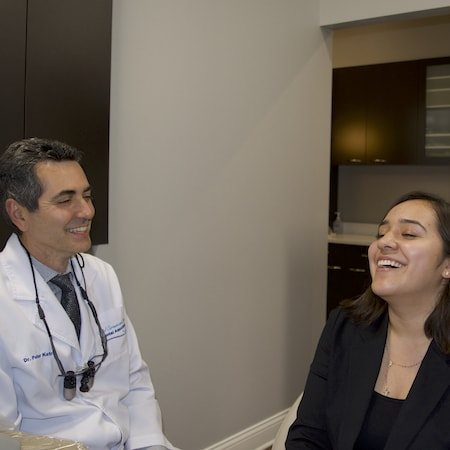 Dr. Katris laughing with Jasmin as they sit in a consultation room
