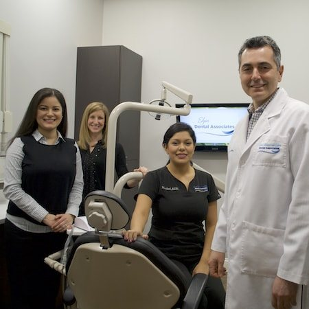 Dr. Katris smiling with our Elgin team at one of our offices